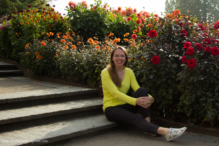 Posing by the stunning Dahlia Gardens in full bloom on Mainau Island, Germany