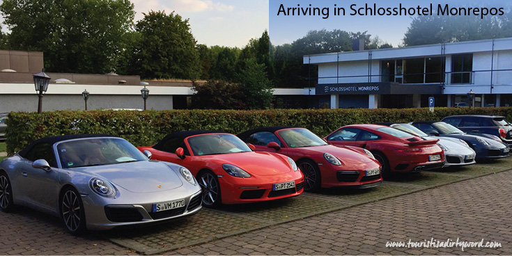 Schlosshotel Monrepos with Porsche cars lined up in front