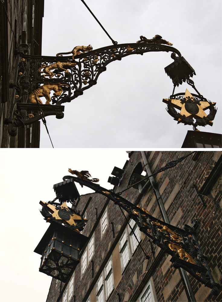 The gilded wrought iron fixture extending from the Deutsche Haus in Bremen, Germany, featuring the Bremen Town Musicians.