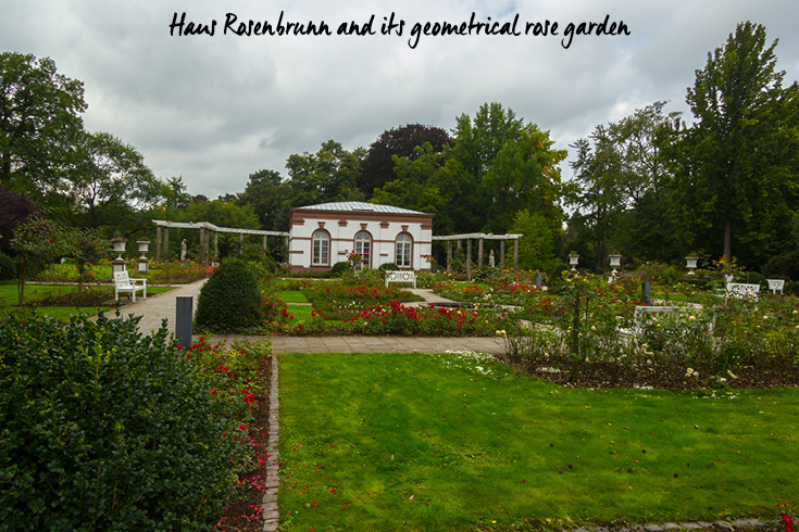 Haus Rosenbrunn and its geometrical rose garden in Palmengarten in Frankfurt am Main, Germany