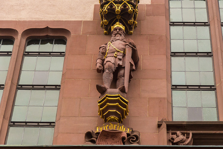 Typical for neo-gothic, or gothic revival architecture, all structural elements are decorated. Four Kings, such as Friedrich I, are on the Roemer facade in Frankfurt.