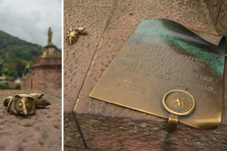 "Beside the plaque you can see 2 mice, which is the creative ""signature"" of Prof. Gernot Rumpf, who has created the monkey sculpture and many more sculptures and fountains all over Germany."