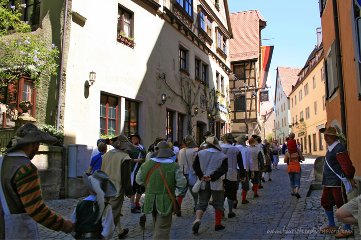 Historically costumed re-enactors march down the streets of Rothenburg during the Master Draught Festival